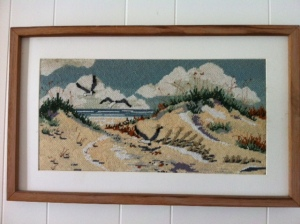 Beach scene in needlepoint.